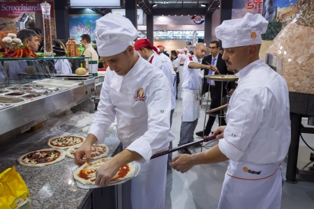 hospitality industry: MILAN, ITALY - OCTOBER 18  Pizza preparation at Host 2013, international exhibition of the hospitality industry on OCTOBER 18, 2013 in Milan  Editorial