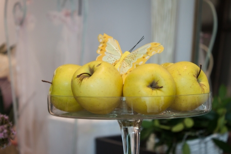 passions: MILAN, ITALY - NOVEMBER 1  Yellow apples with butterfly at Weekend Donna 2013, event dedicated to women and their passions on NOVEMBER 1, 2013 in Milan