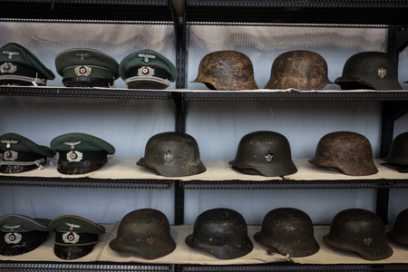 MILAN, ITALY - NOVEMBER 2  Nazi helmets and hats on display at Militalia, exhibition dedicated to militaria collectors and military associations on NOVEMBER 2, 2013 in Milan