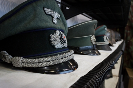 MILAN, ITALY - NOVEMBER 2  Nazi hats on display at Militalia, exhibition dedicated to militaria collectors and military associations on NOVEMBER 2, 2013 in Milan