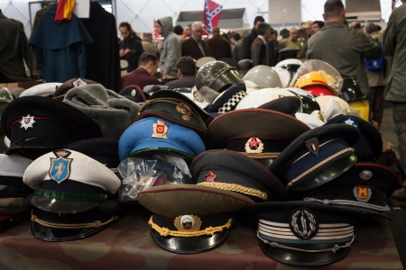 MILAN, ITALY - NOVEMBER 2  Russian military hats at Militalia, exhibition dedicated to militaria collectors and military associations on NOVEMBER 2, 2013 in Milan