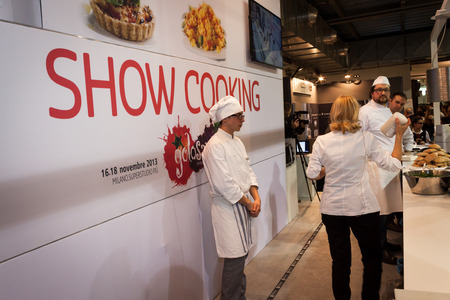 important event: MILAN, ITALY - NOVEMBER 16: Cooks during a show cooking at Golosaria, important event dedicated to culture and tradition of quality food and wine on NOVEMBER 16, 2013 in Milan. Editorial