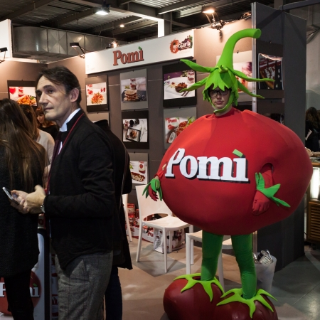 MILAN, ITALY - NOVEMBER 16: Tomato man stands at Golosaria, important event dedicated to culture and tradition of quality food and wine on NOVEMBER 16, 2013 in Milan.