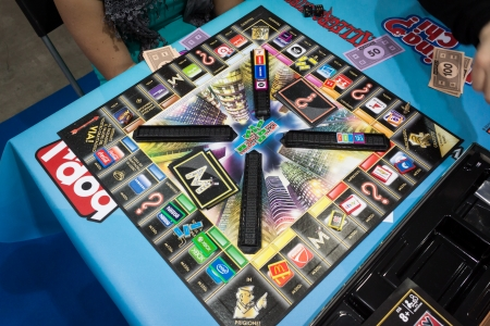 MILAN, ITALY - NOVEMBER 22  Monopoly board game at G  come giocare, trade fair dedicated to games, toys and children on NOVEMBER 22, 2013 in Milan  Editorial