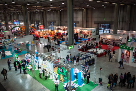 MILAN, ITALY - NOVEMBER 22  Top view of people and booths at G  come giocare, trade fair dedicated to games, toys and children on NOVEMBER 22, 2013 in Milan
