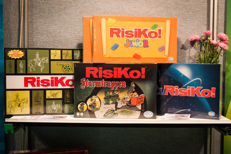risiko: MILAN, ITALY - NOVEMBER 22  Risiko boxes on display at G  come giocare, trade fair dedicated to games, toys and children on NOVEMBER 22, 2013 in Milan