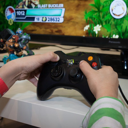 MILAN, ITALY - NOVEMBER 22  Detail of Xbox controller at G  come giocare, trade fair dedicated to games, toys and children on NOVEMBER 22, 2013 in Milan