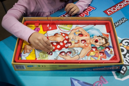 MILAN, ITALY - NOVEMBER 22  Operation board game at G  come giocare, trade fair dedicated to games, toys and children on NOVEMBER 22, 2013 in Milan  Editorial