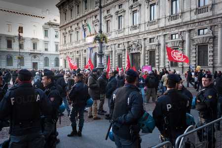 demonstrators: MILAN, ITALY - DECEMBER 7  Workers gather in front of La Scala opera house to protest during the premiere of La Traviata on DECEMBER 7, 2013 in Milan