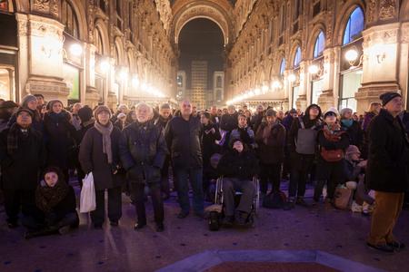 verdi: MILAN, ITALY - DECEMBER 7  People look at the screen broadcasting Verdi