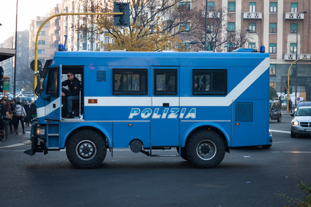 demonstrators: MILAN, ITALY - DECEMBER 10: Police truck during a demonstration against government and politicians on DECEMBER 10, 2013 in Milan. Editorial