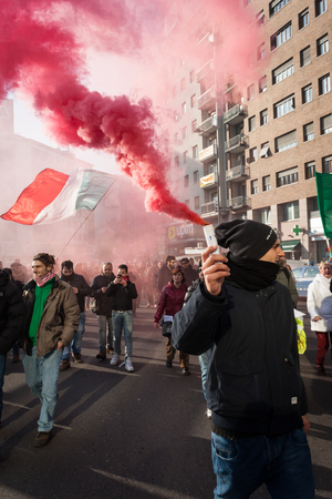 demonstrators: MILAN, ITALY - DECEMBER 10: Demonstrators occupy the city streets blocking the traffic to protest against government and politicians on DECEMBER 10, 2013 in Milan.