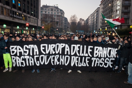 demonstrators: MILAN, ITALY - DECEMBER 11  Demonstrators occupy the city streets blocking the traffic to protest against government and politicians on DECEMBER 11, 2013 in Milan