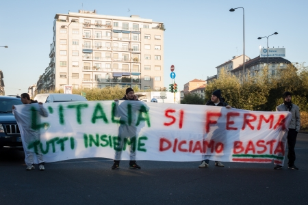 demonstrators: MILAN, ITALY - DECEMBER 13: Demonstrators occupy the city streets blocking the traffic to protest against government and politicians on DECEMBER 13, 2013 in Milan.