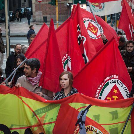 demonstrators: MILAN, ITALY - DECEMBER 14  People partecipate in an antifascist march to celebrate piazza Fontana bombing anniversary on DECEMBER 14,2013 in Milan