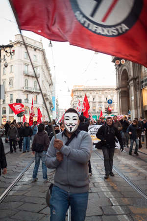 occupy movement: MILAN, ITALY - DECEMBER 14  People partecipate in an antifascist march to celebrate piazza Fontana bombing anniversary on DECEMBER 14,2013 in Milan