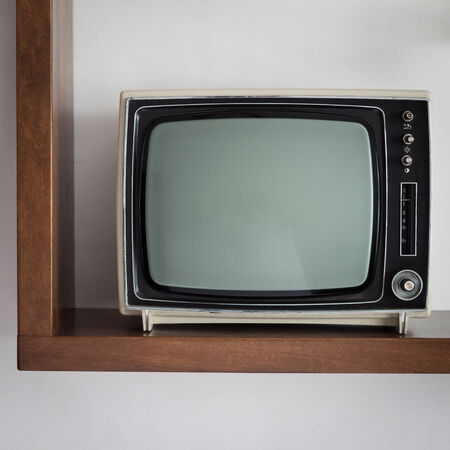 Portable vintage television on a shelf photo