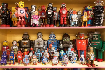 tinplate: MILAN, ITALY - JANUARY 20: Vintage tinplate robots on display at HOMI, home international show and point of reference for all those in the sector of interior design on JANUARY 20, 2014 in Milan. Editorial