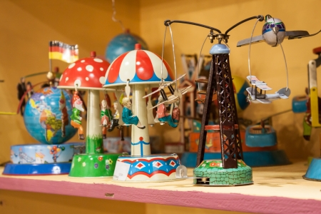 MILAN, ITALY - JANUARY 20: Vintage tinplate toys on display at HOMI, home international show and point of reference for all those in the sector of interior design on JANUARY 20, 2014 in Milan. Editorial