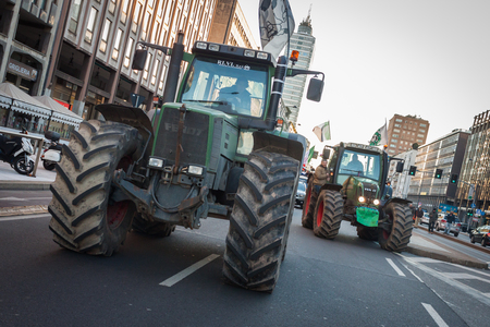 occupy movement: MILAN, ITALY - JANUARY 25: Demonstrators of the so-called December 9 movement drive their tractors in the city streets to protest against government and political class on JANUARY 25, 2013 in Milan.