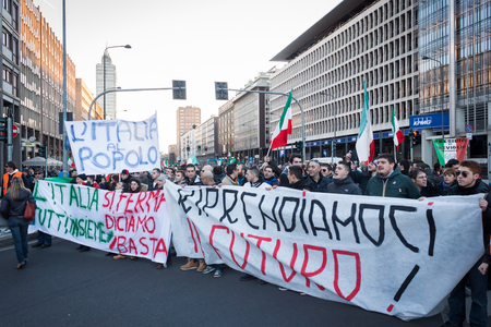 demonstrators: MILAN, ITALY - JANUARY 25: Demonstrators of the so-called December 9 movement march in the city streets to protest against government and political class on JANUARY 25, 2013 in Milan.  Editorial