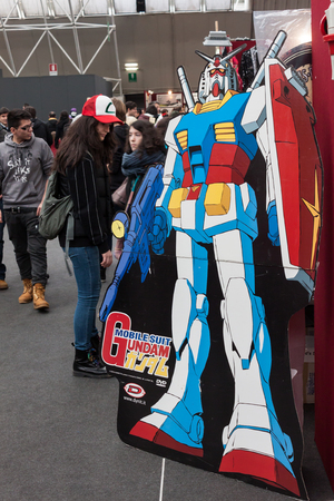roleplaying: MILAN, ITALY - FEBRUARY 2: Gundam robot and people at Festival del Fumetto, convention dedicated to comics and cosplay world on FEBRUARY 2, 2014 in Milan.