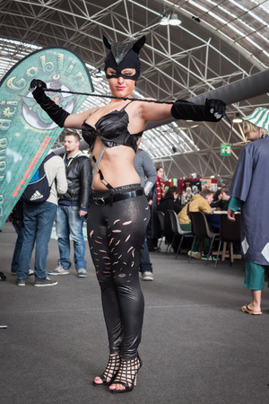 catwoman: MILAN, ITALY - FEBRUARY 2: Catwoman cosplayer poses at Festival del Fumetto, convention dedicated to comics and cosplay world on FEBRUARY 2, 2014 in Milan.