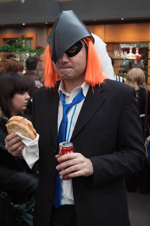 MILAN, ITALY - FEBRUARY 2: Cosplayer eats a sandwich at Festival del Fumetto, convention dedicated to comics and cosplay world on FEBRUARY 2, 2014 in Milan.