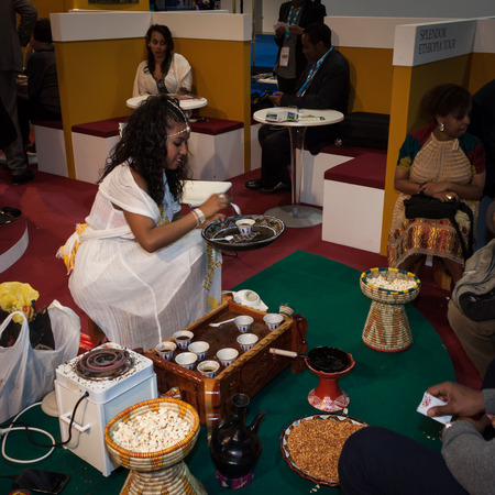 reference point: MILAN, ITALY - FEBRUARY 13  Ethiopian woman serves traditional coffee at Bit, international tourism exchange reference point for the travel industry on FEBRUARY 13, 2014 in Milan  Editorial