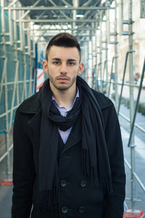 Portrait of a handsome young man with scarf photo