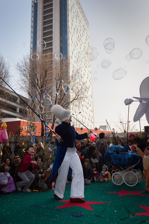 MILAN, ITALY - MARCH 8: Artist creates giant soap bubbles at Milan Clown Festival, international event dedicated to clowns and street theatre on MARCH 8, 2014 in Milan.
