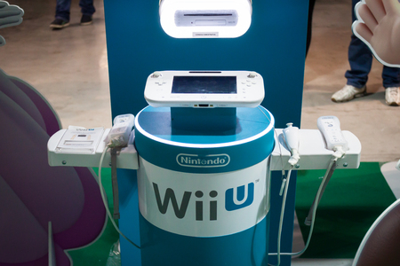 nintendo: MILAN, ITALY - MARCH 14: Nintendo console on display at Cartoomics, event dedicated to comics, cartoons, cosplay, fantasy and gaming on MARCH 14, 2014 in Milan Editorial
