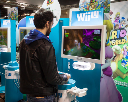nintendo: MILAN, ITALY - MARCH 14: Nintendo stand at Cartoomics, event dedicated to comics, cartoons, cosplay, fantasy and gaming on MARCH 14, 2014 in Milan Editorial
