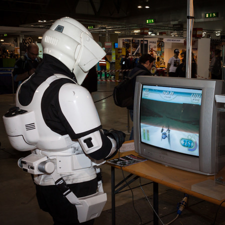 stormtrooper: MILAN, ITALY - MARCH 14: Guy plays vintage video game at Cartoomics, event dedicated to comics, cartoons, cosplay, fantasy and gaming on MARCH 14, 2014 in Milan Editorial