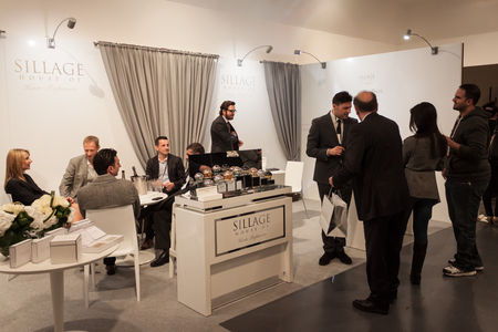 eau de perfume: MILAN, ITALY - MARCH 21: People visit Esxence, the art perfumerys event on MARCH 21, 2014 in Milan, Italy