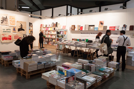 28: MILAN, ITALY - MARCH 28: People visit bookstore at Miart, international exhibition of modern and contemporary art on MARCH 28, 2014 in Milan.