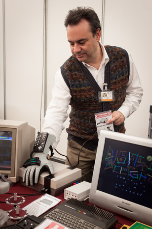 MILAN, ITALY - MARCH 30: Guy with electronic glove at Robot and Makers Milano Show, event dedicated to robotics and makers on MARCH 30, 2014 in Milan.