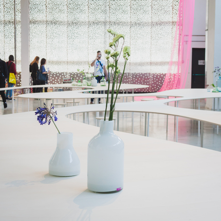 MILAN, ITALY - APRIL 11: Vases with flowers on display for Fuorisalone at Ventura Lambrate space, location of important events during Milan Design week on APRIL 11, 2014 in Milan