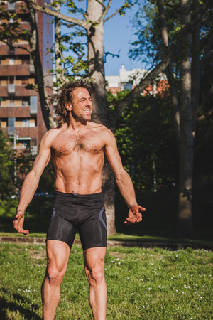 Mature long haired athlete getting ready for running photo