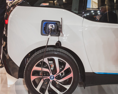 MILAN, ITALY - MAY 7: Detail of an electric car under charge at Solarexpo, international exhibition for promoting innovative and renewable energy technology on MAY 7, 2014 in Milan.