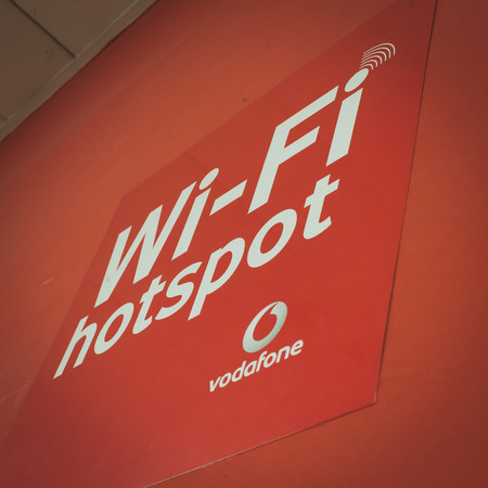 MILAN, ITALY - MAY 7: Vodafone wi-fi sign at Solarexpo, international exhibition for promoting innovative and renewable energy technology on MAY 7, 2014 in Milan.