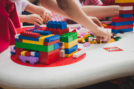 MILAN, ITALY - MAY 10: Children play at Lego Village, event held in the city streets to promote creativity and manual ability on MAY 10, 2014 in Milan. Publikacyjne