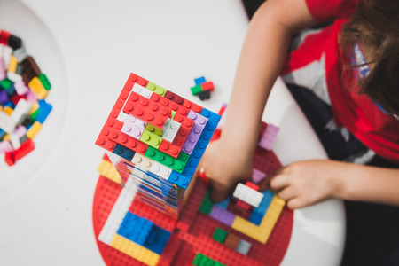 MILAN, ITALY - MAY 10: Child plays at Lego Village, event held in the city streets to promote creativity and manual ability on MAY 10, 2014 in Milan. Editorial