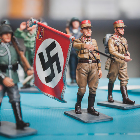 MILAN, ITALY - MAY 18: Nazi toy soldier with flag on display at Militalia, exhibition dedicated to militaria collectors and military associations on MAY 18, 2014 in Milan.