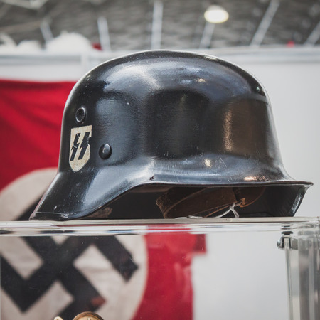 MILAN, ITALY - MAY 18: SS helmet on display at Militalia, exhibition dedicated to militaria collectors and military associations on MAY 18, 2014 in Milan.