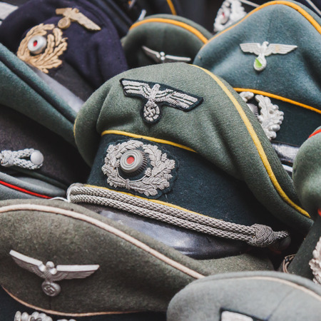MILAN, ITALY - MAY 18: Wehrmacht visor caps on display at Militalia, exhibition dedicated to militaria collectors and military associations on MAY 18, 2014 in Milan.