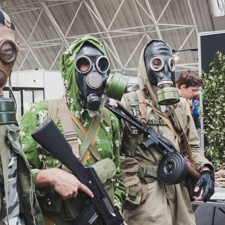 MILAN, ITALY - MAY 18: Soldiers with gas masks pose at Militalia, exhibition dedicated to militaria collectors and military associations on MAY 18, 2014 in Milan.