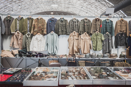 MILAN, ITALY - MAY 18: Stand with uniforms at Militalia, exhibition dedicated to militaria collectors and military associations on MAY 18, 2014 in Milan.