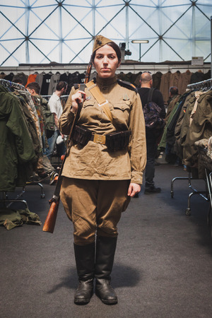MILAN, ITALY - MAY 18: Woman in vintage Russian uniform poses at Militalia, exhibition dedicated to militaria collectors and military associations on MAY 18, 2014 in Milan.