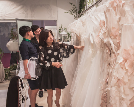 MILAN, ITALY - MAY 23: People visit Si Sposaitalia, ultimate exhibition for bridal and formal wear industry on MAY 23, 2014 in Milan.